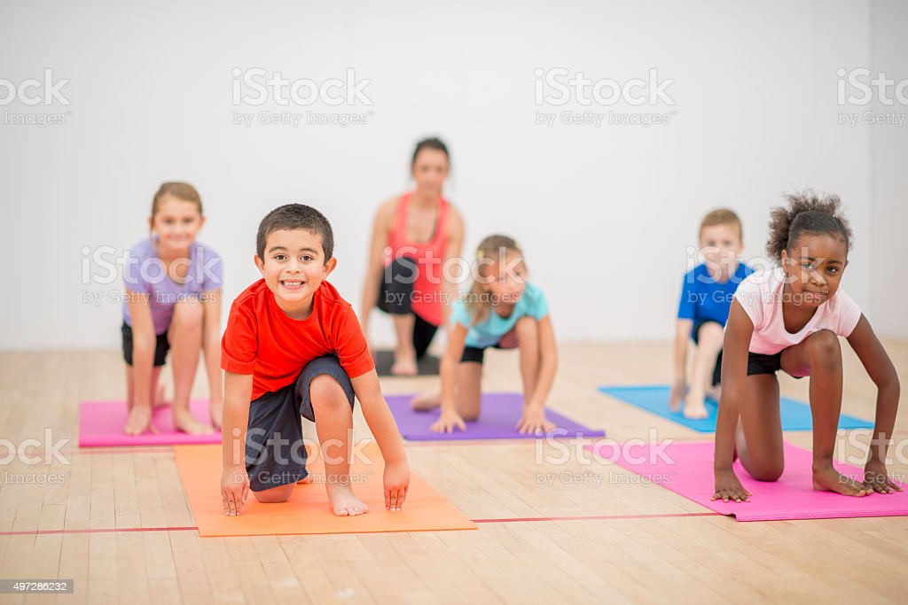 Children Doing Pilates Together stock photo