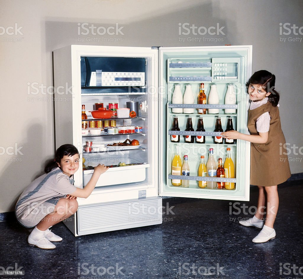 Children doing refrigerator advertising in the 60s stock photo