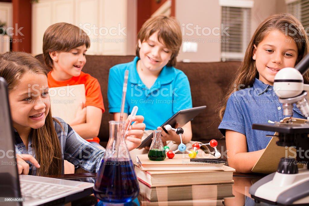 Children doing science homework at home. royalty-free stock photo
