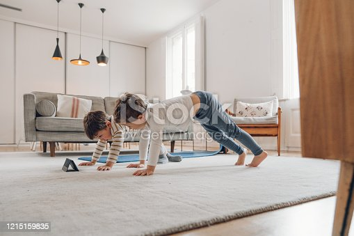 Children doing Yoga at home
