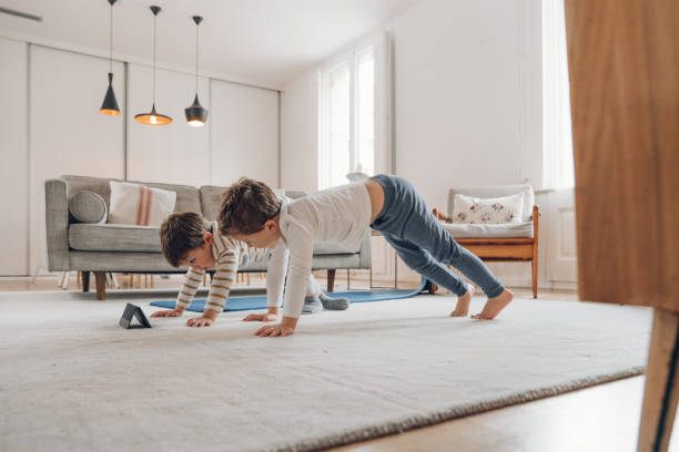 Children doing Yoga at home stock photo