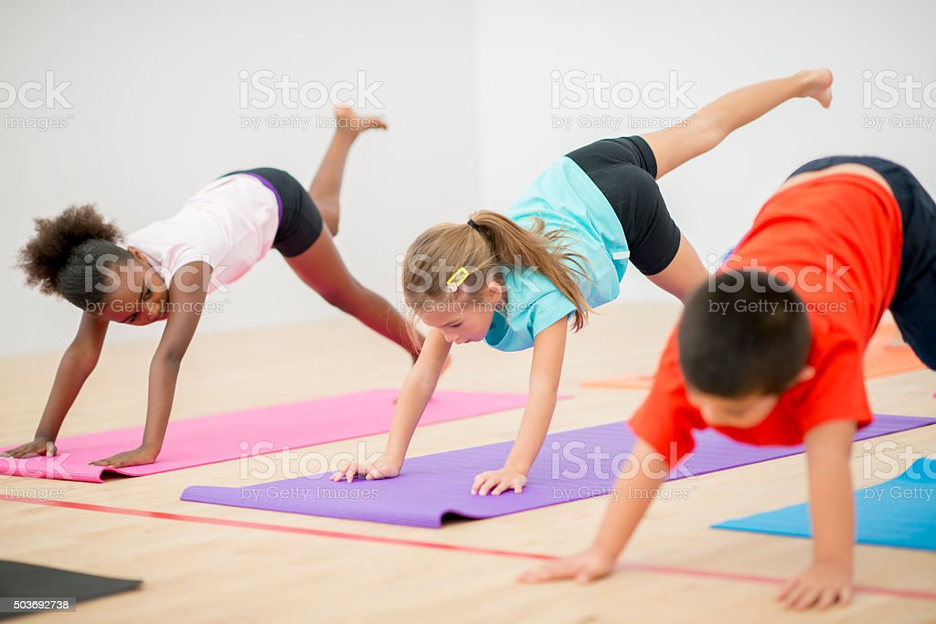 Children Doing Yoga at the Gym stock photo