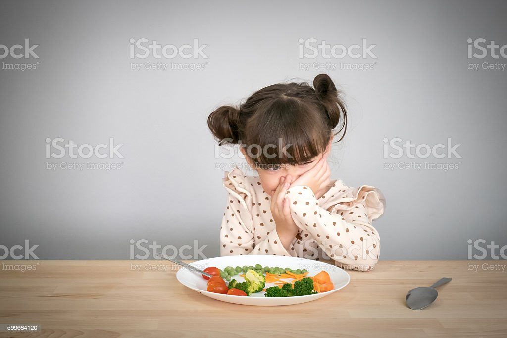 children don't want to eat vegetables stock photo