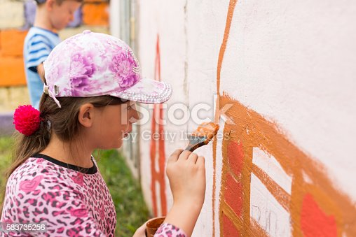 istock children draw a picture on the wall 583735256