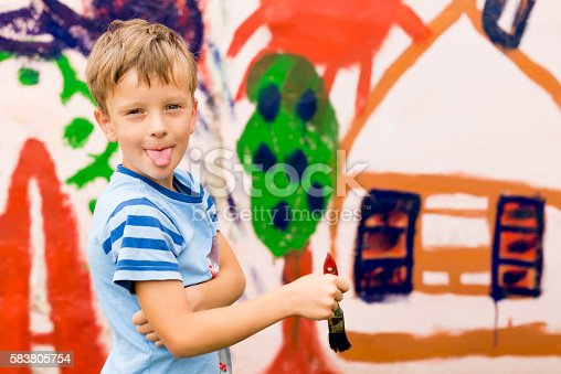 istock children draw a picture on the wall 583805754