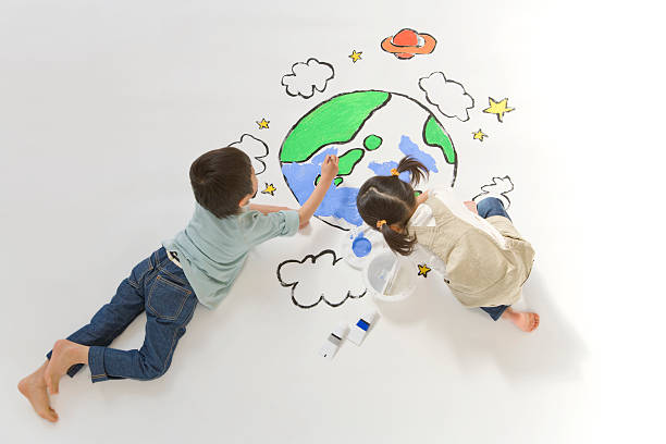 Children drawing a picture of earth stock photo