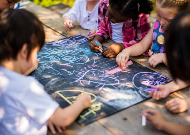 Children drawing art class outdoors stock photo