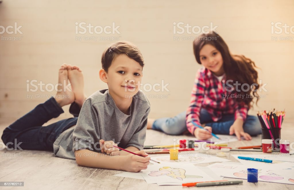 Children drawing at home stock photo