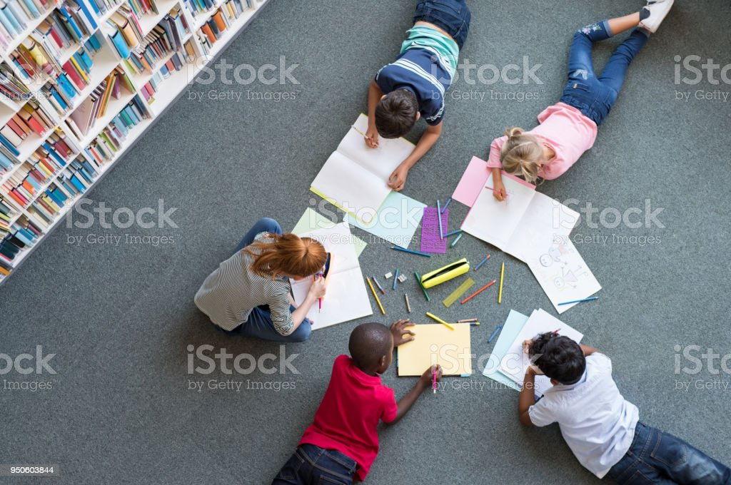 Children drawing at library stock photo