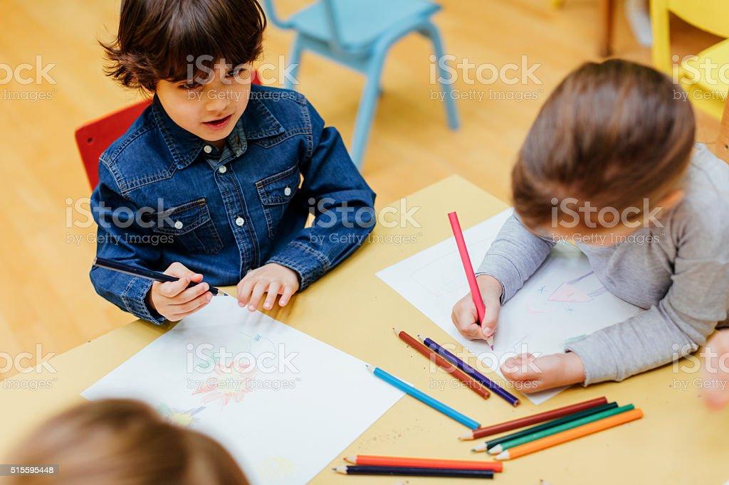 Children drawing in kindergarten stock photo
