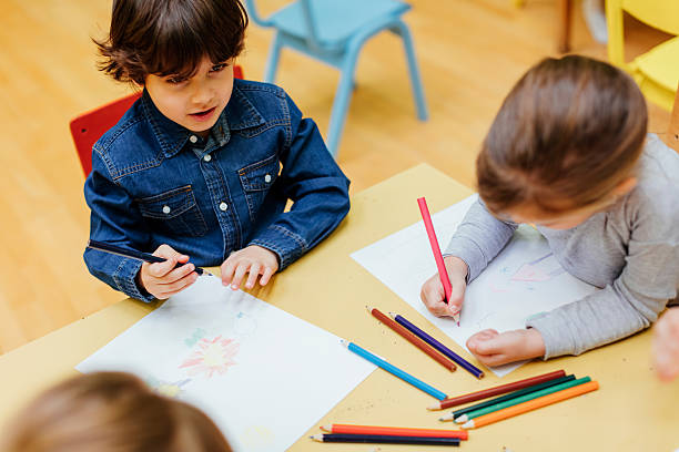 children drawing in kindergarten - colouring book stock photos and pictures