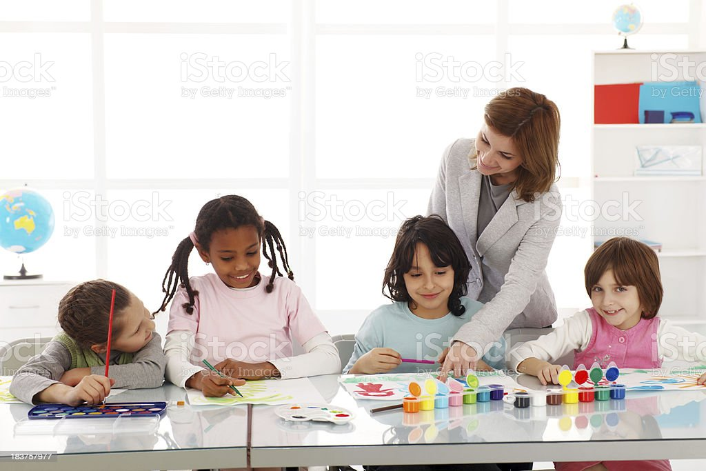 Children drawing with watercolors on art class. royalty-free stock photo