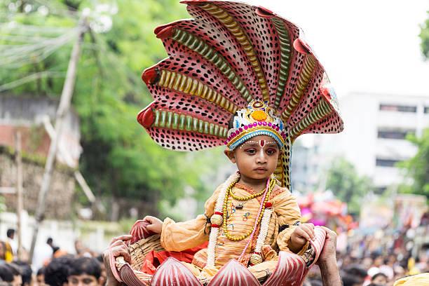 children dressed as Lord Krishna stock photo