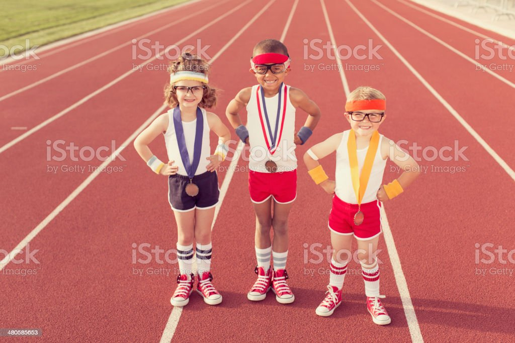Children Dressed as Nerds at Track Wearing Medals stock photo