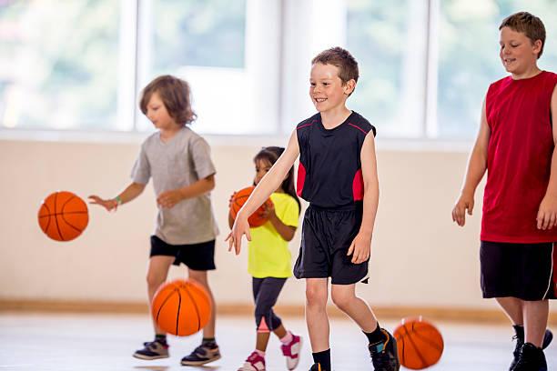 Children Dribbling a Basketball stock photo