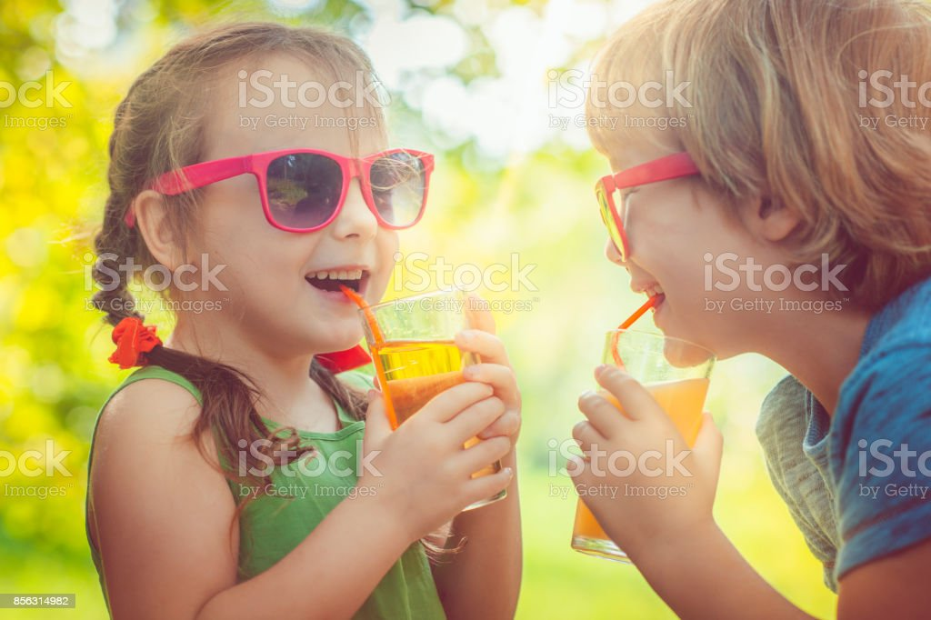 Children drinking juice stock photo