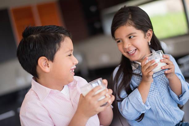 Children drinking milk stock photo