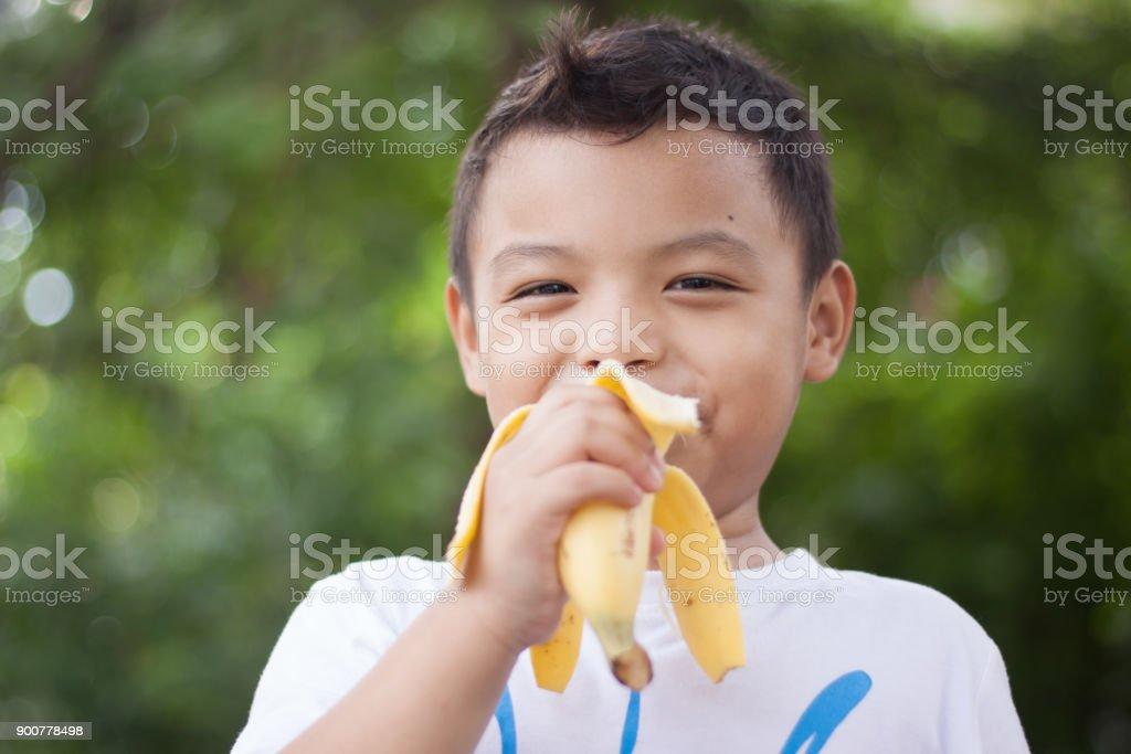 Children eat bananas for health. stock photo