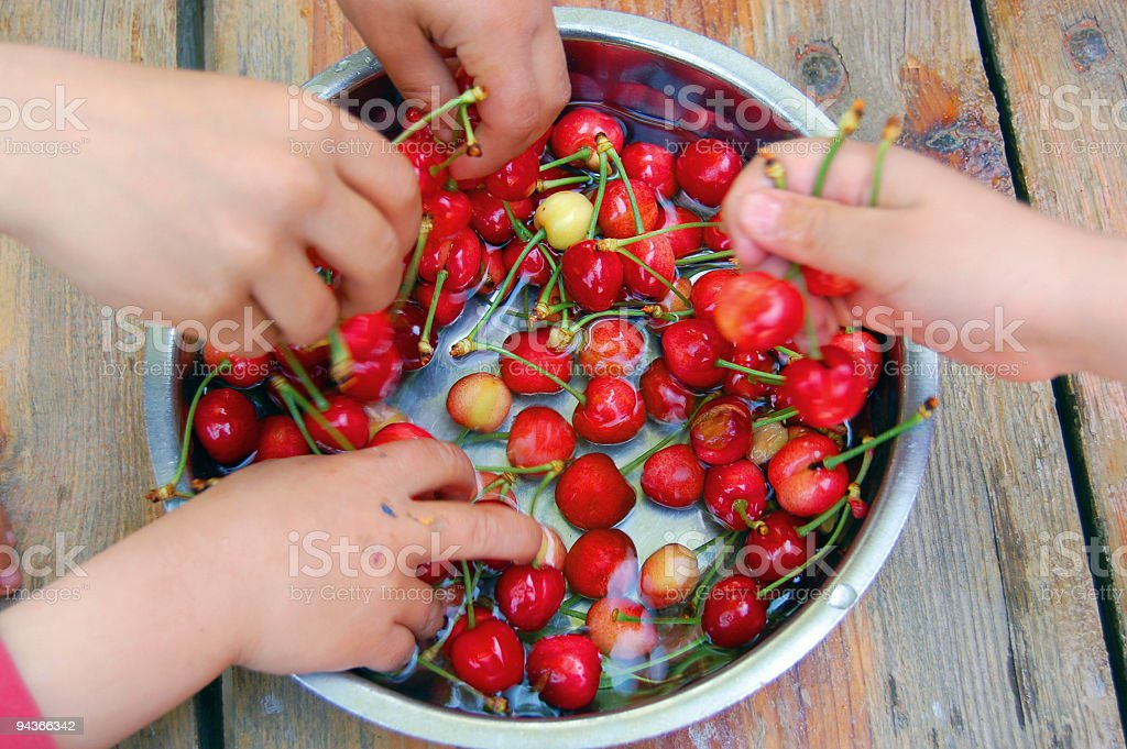 Children Eating Cherry From Plate royalty-free stock photo