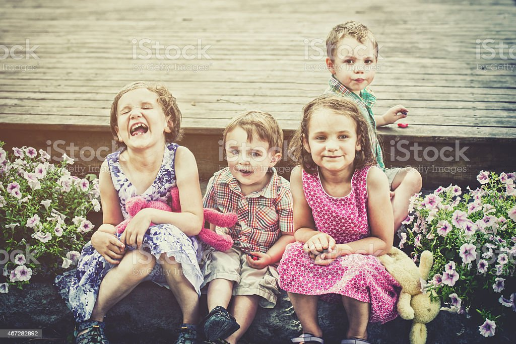 Children Eating Easter Candy Outside - Retro stock photo