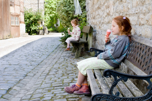 Children Eating Icecream In Medieval Village Stock Photo - Download Image Now