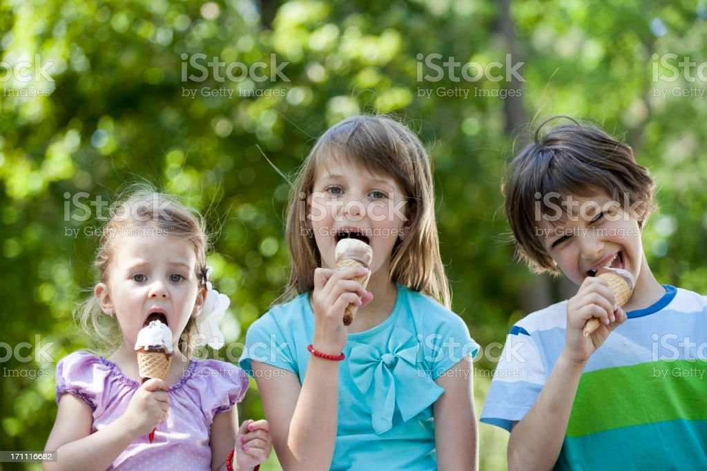 Children eating icecream royalty-free stock photo