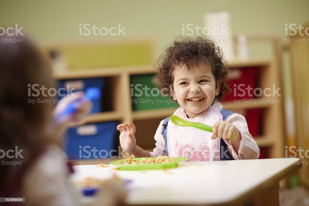 Children eating lunch in kindergarten stock photo