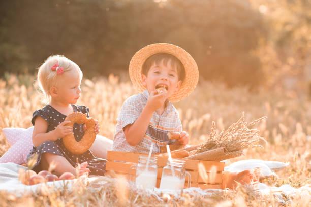 Children eating outdoors stock photo