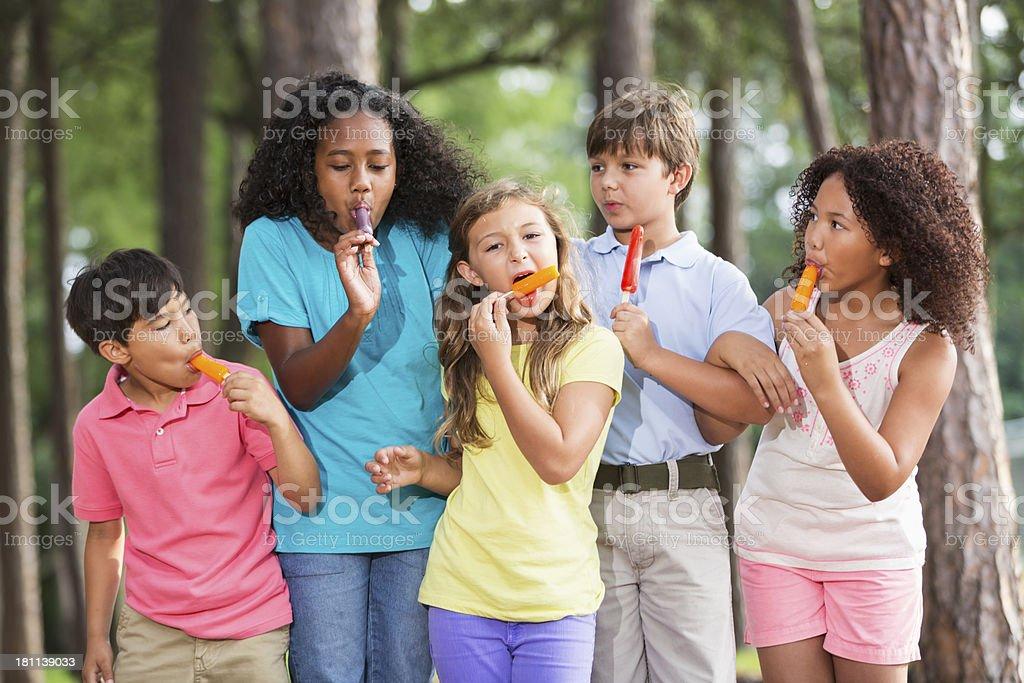 Children eating popsicles royalty-free stock photo