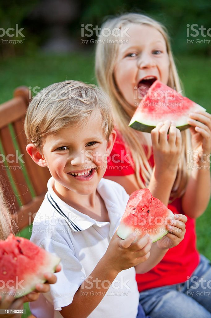 Children eating watermelon royalty-free stock photo