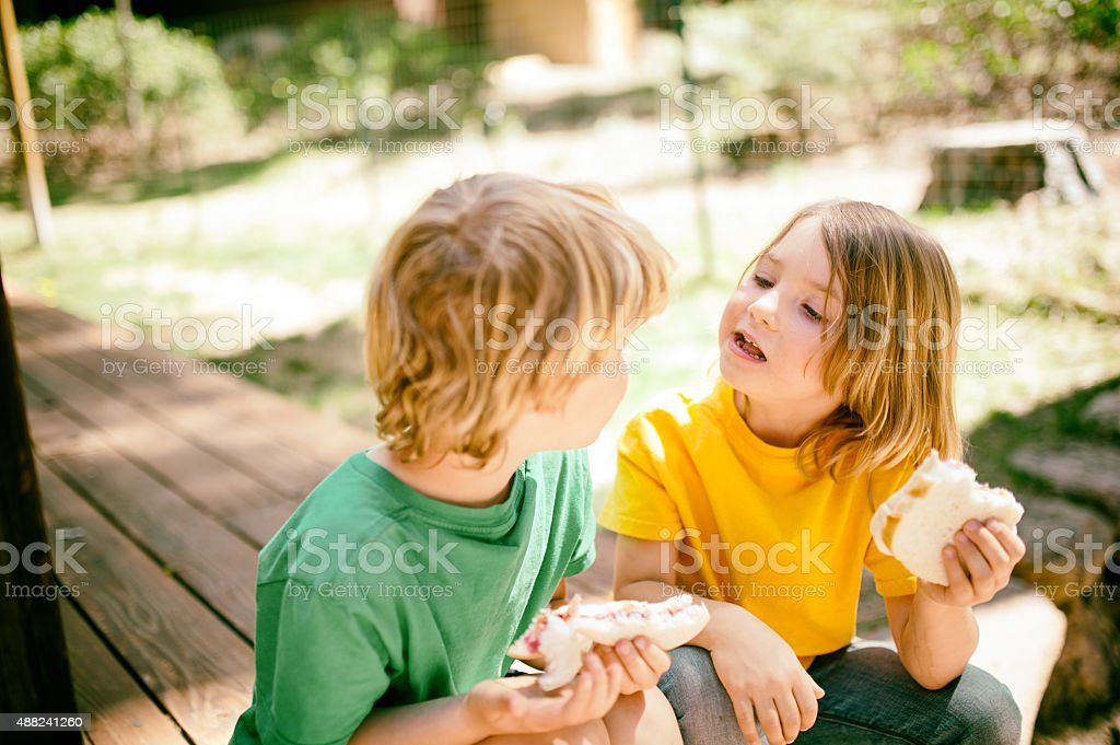Children enjoy lunch together stock photo