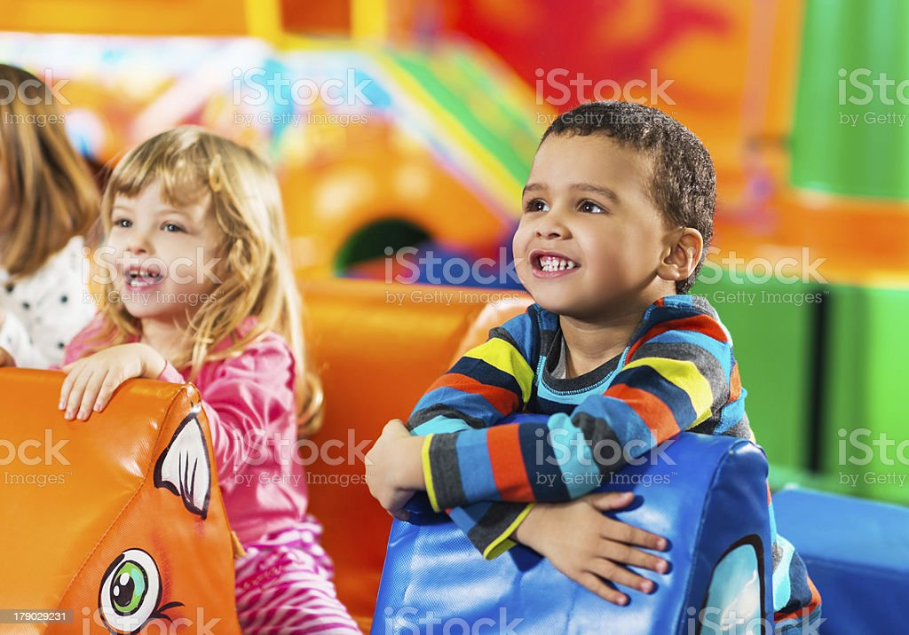 Children enjoying in the playroom. stock photo