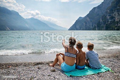 istock Children enjoying pebble beach of Rive del Garda at Garda Lake, Italy 1063460324