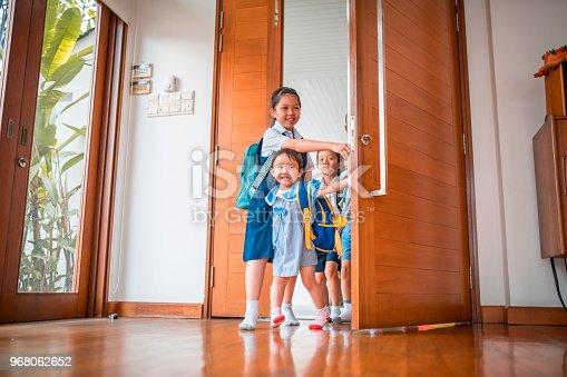 670900812istockphoto Children entering their home 968062652