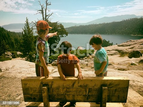 Three children enjoy the beauty of Lake Tahoe together