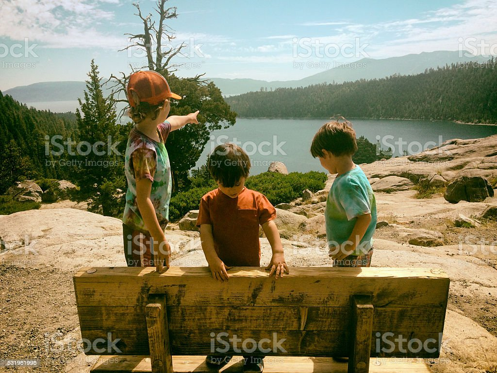 Children exploring, hiking, and enjoying Lake Tahoe together stock photo