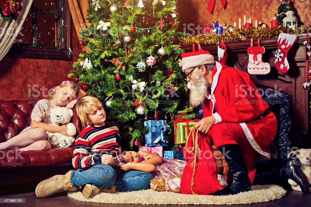 Children fallen asleep while waiting for Santa Claus stock photo