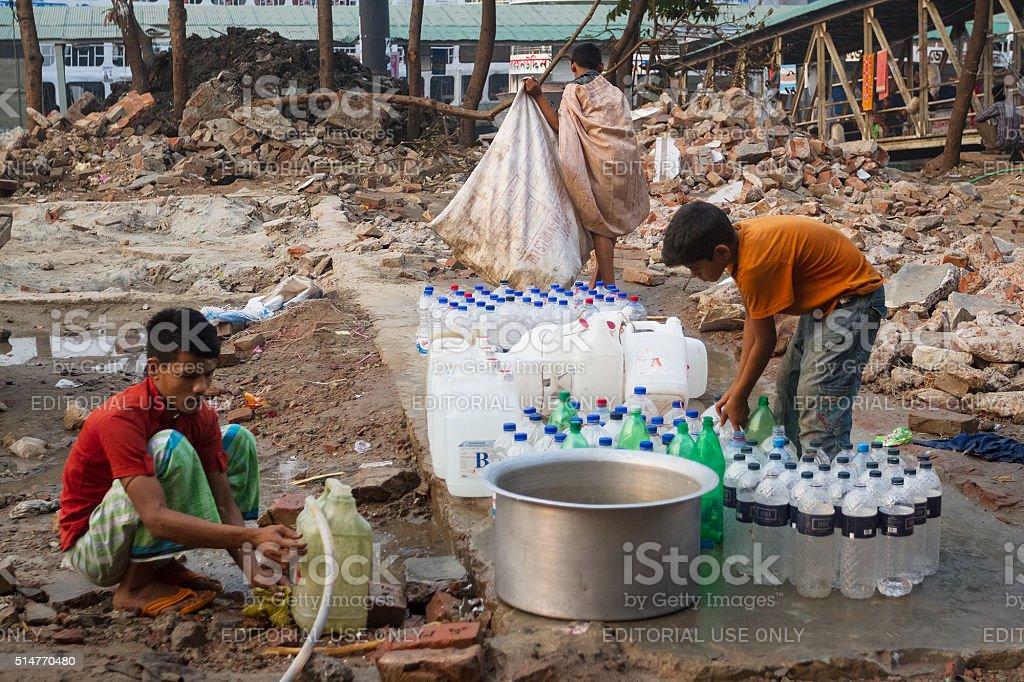 Children Filling Water Bottles stock photo