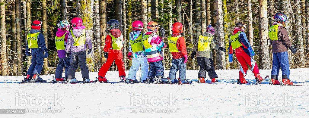 Children form ski school groups during the annual winter school stock photo