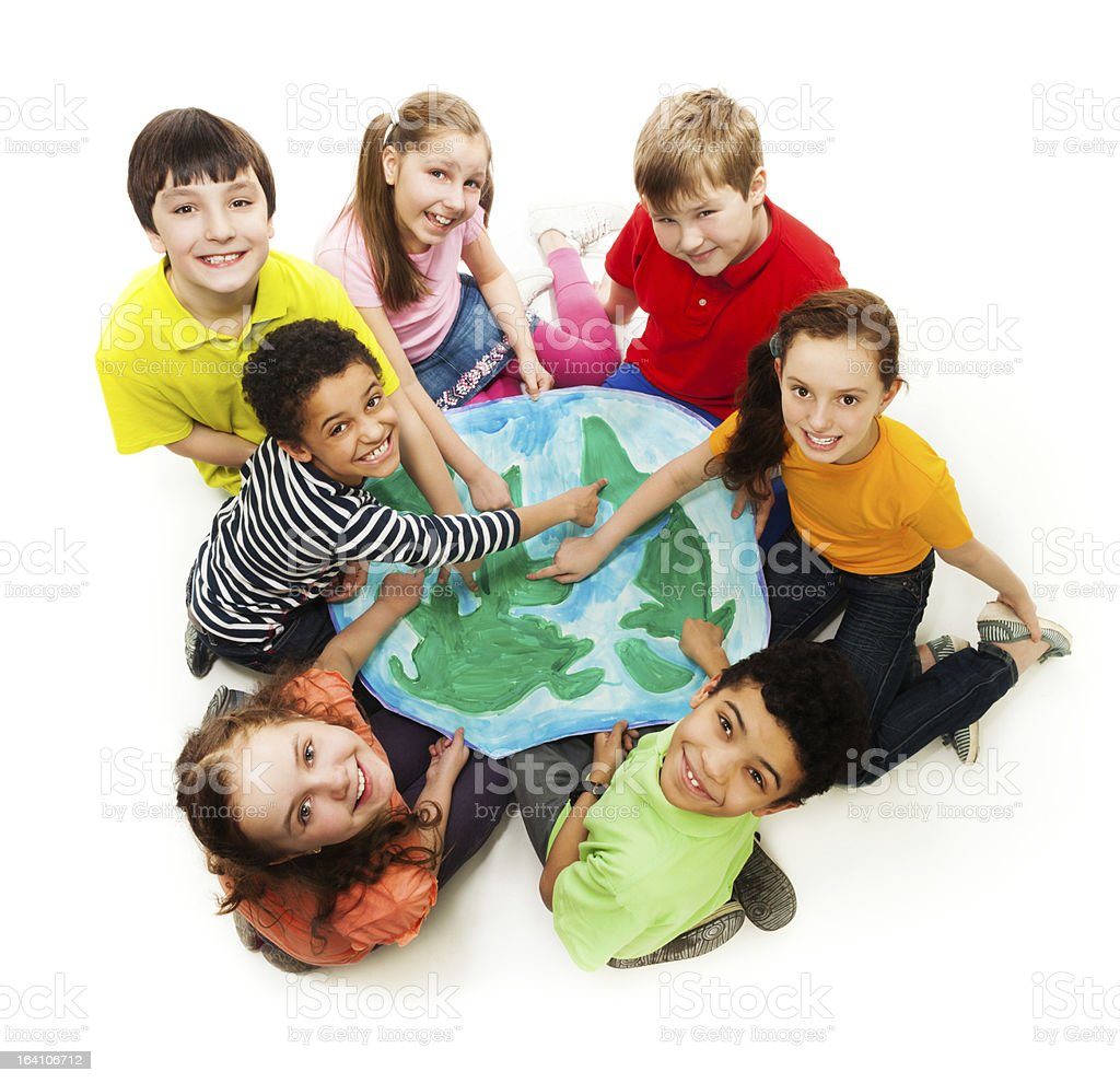 Children from all over world holding a picture of earth stock photo