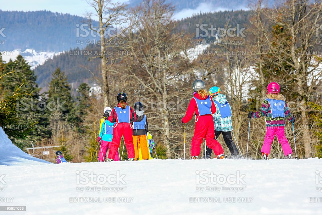 Children from ski school groups during the annual winter school stock photo