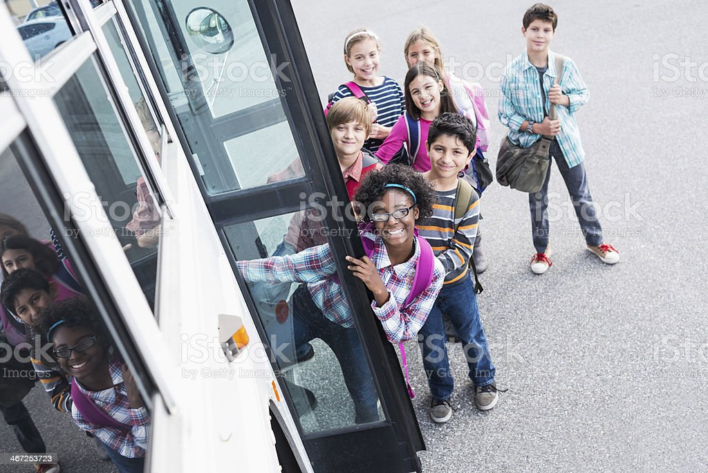 Children getting on school bus royalty-free stock photo