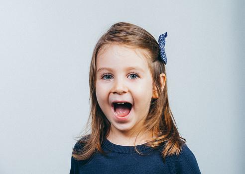 istock children girl enjoying screaming expression 511609970