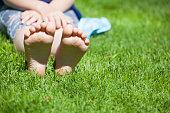 children girl foot grass background