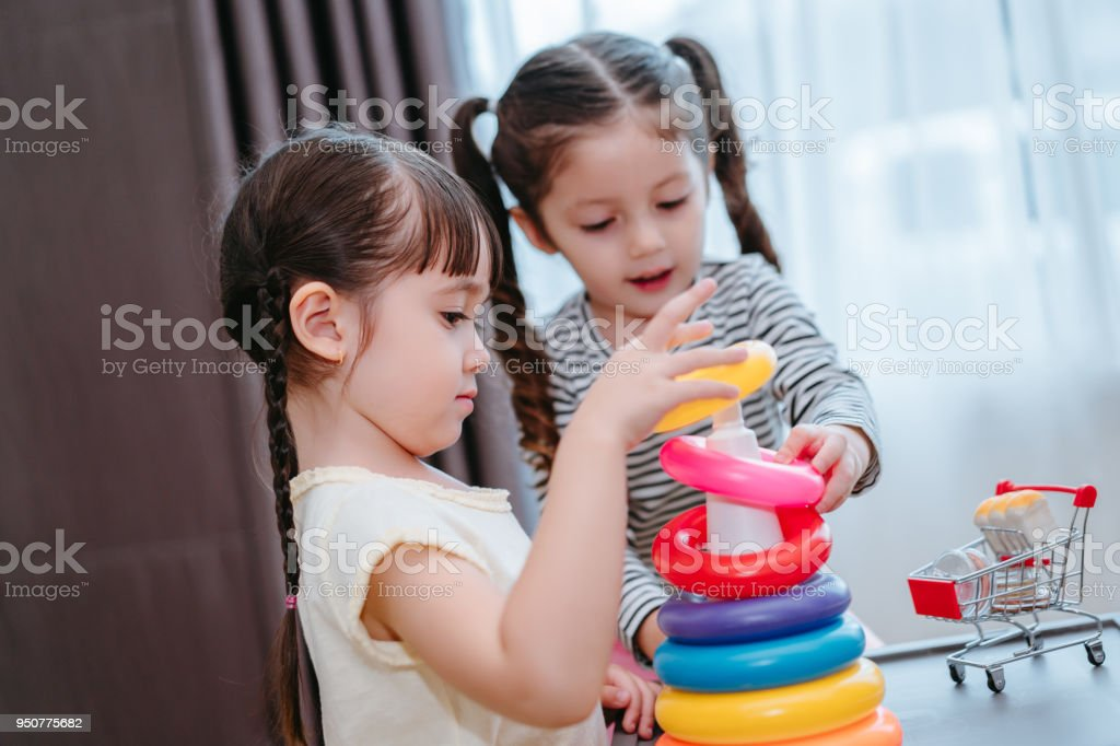 Children Girls Play A Toy Games In The Room Kids Playing