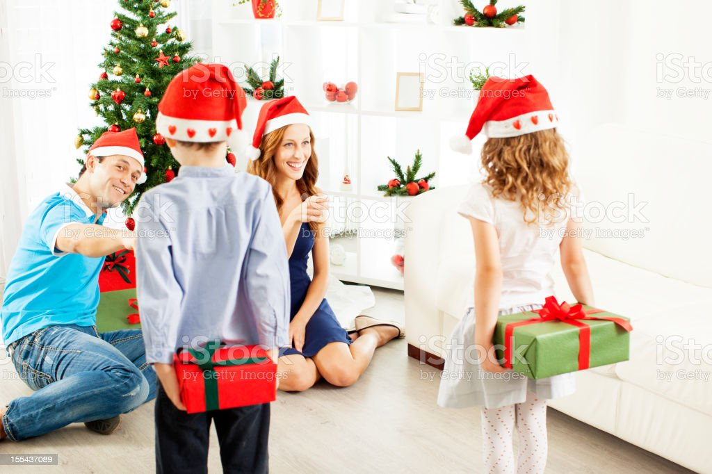 Christmas Gifts For Parents.Children Giving Christmas Gifts To Parents Stock Photo