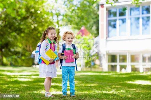 istock Children going back to school, year start 990589018