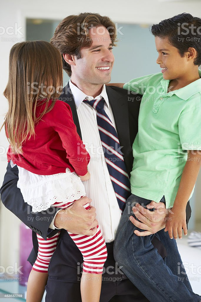 Children Greeting Father On Return From Work royalty-free stock photo