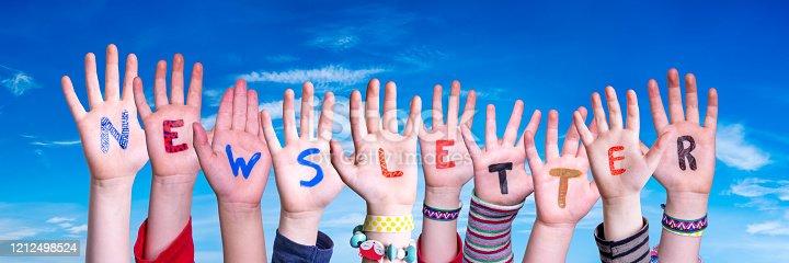 1132886484 istock photo Children Hands Building Word Newsletter, Blue Sky 1212498524
