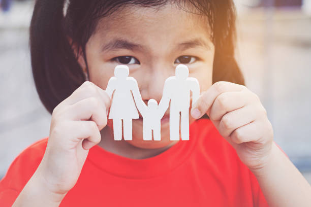 Children hands holding small model family , concept family stock photo